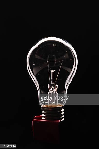 Light bulb on black background