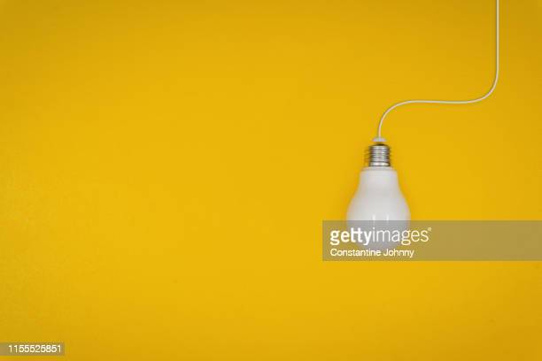 light bulb on yellow background. - execution stock pictures, royalty-free photos & images