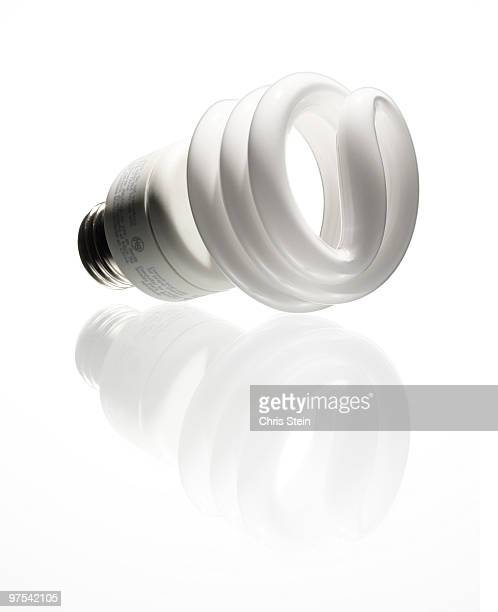 cfl light bulb - energy efficient lightbulb stock photos and pictures