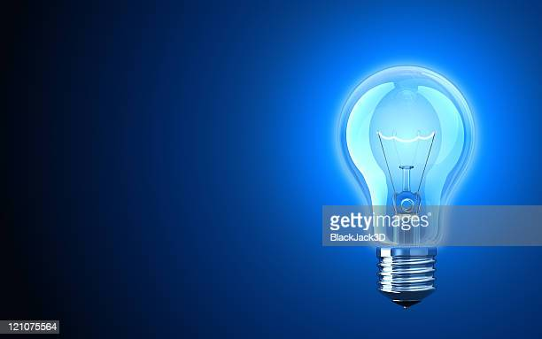 light bulb providing blue light - light bulb stock pictures, royalty-free photos & images