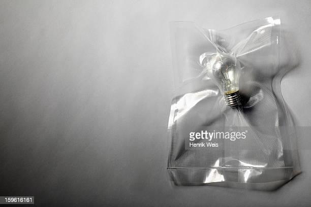 Light bulb shrink wrapped in plastic