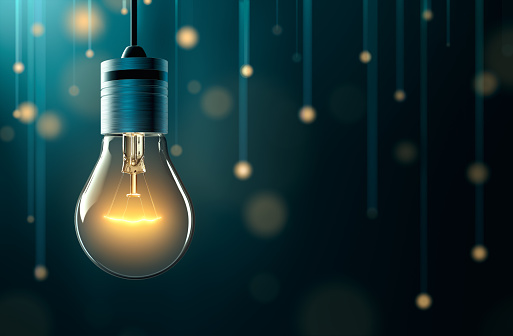 Light bulb with hanging lights background 1023387542
