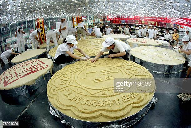 Light bulbs are used to bake a giant mooncake measuring 815 meters in diameter and weighing approximately 13 metric tons on August 21 2007 in...