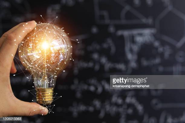light bulbs concept,ideas of new ideas with innovative technology and creativity. - solutions stock pictures, royalty-free photos & images