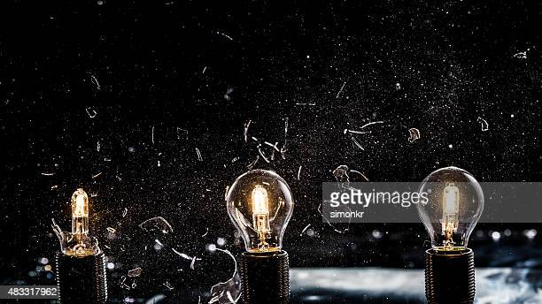 light bulbs exploding - exploding glass stock photos and pictures