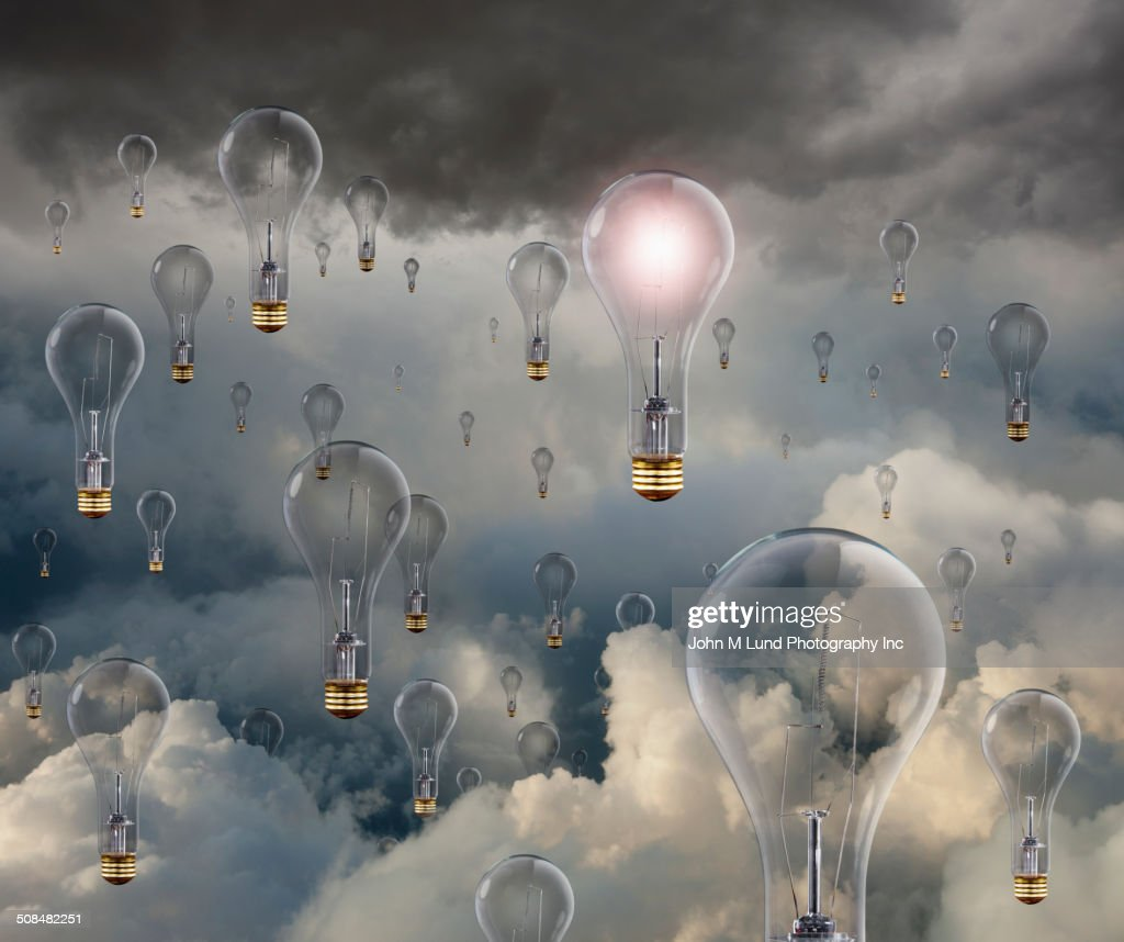 Light bulbs floating in clouds : Stock Photo