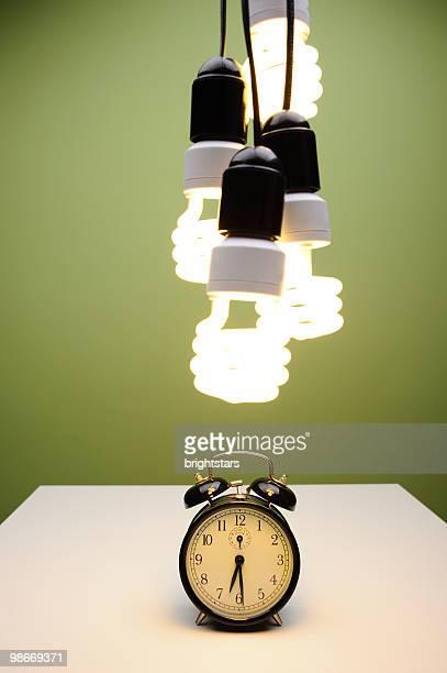 Light bulbs over alarm clock