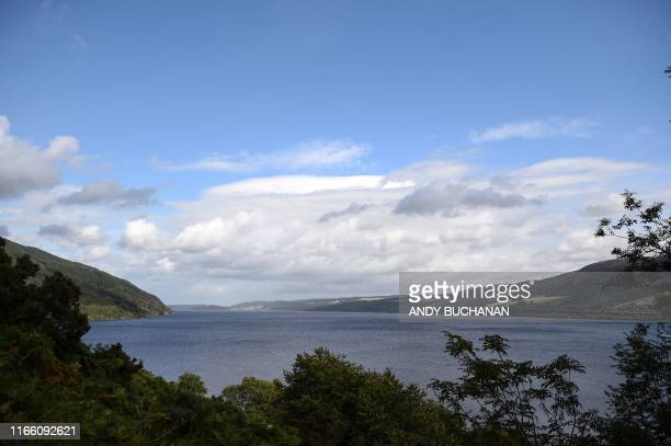 Light clouds cover the sky above Loch Ness in Drumnadrochit Scotland on September 5 2019