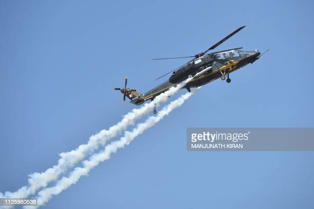 Light Combat Helicopter of the Indian Air Force takes part in a flying display on the inaugural day of the fiveday Aero India airshow at the...