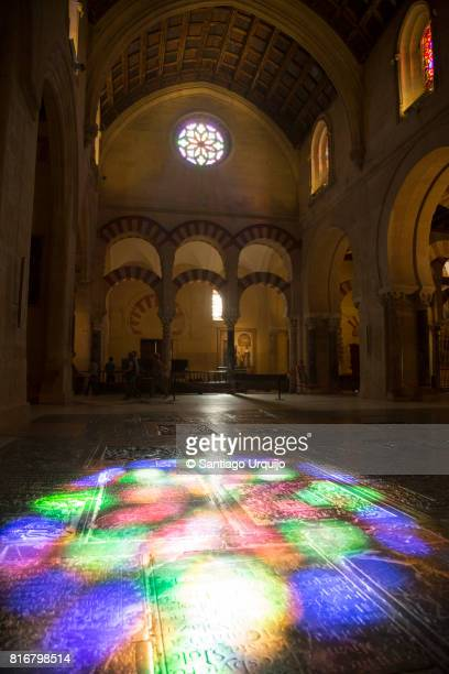 Light coming through a rose window reflected on ground