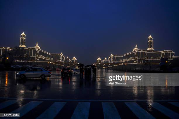 light decoration at the president house and parliament house on the eve of india's republic day 2017 - india gate delhi stock pictures, royalty-free photos & images