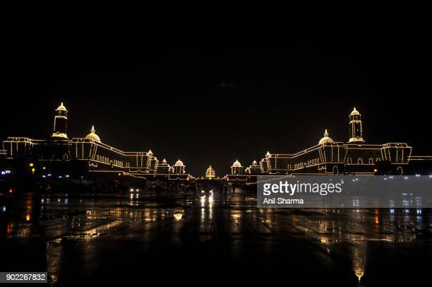 light decoration at the president house and parliament house on the eve of india's republic day 2017. - parade stock pictures, royalty-free photos & images