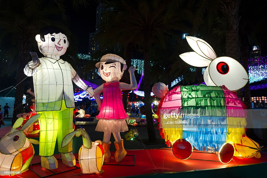 Light decorations are displayed as mid-Autumn celebrations take place at dusk on September 24, 2015 in Victoria Park, Hong Kong. The Mid-Autumn Festival is a harvest festival celebrated by ethnic Chinese. The festival is held on the 15th day of the eighth month in the Chinese Han calendar, on the night of the full moon between early September to early October of the Gregorian calendar. It is also called Moon Festival, Harvest Moon Festival, Mooncake Festival, or Zhongqiu Festival, its official pinyin name.