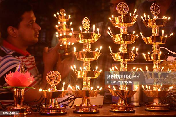 Light decorations are pictured at a shop ahead of Diwali in Amritsar on November 6 2012 Electric lights and traditional lamps are in heavy demand for...