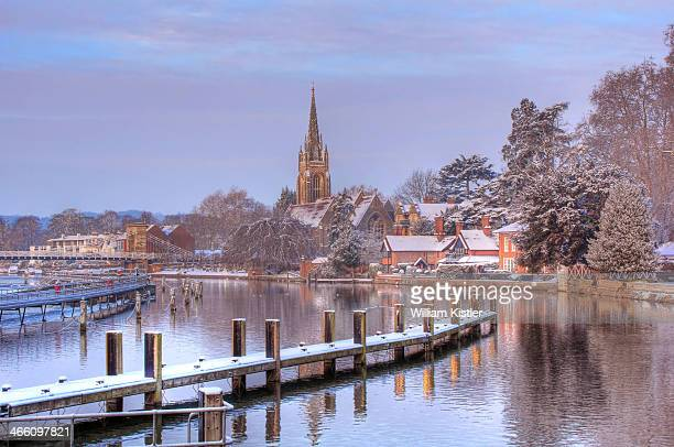 Light dusting f snow at the weir at Marlow lock on the River Thames. All Saints Marlow church in background.