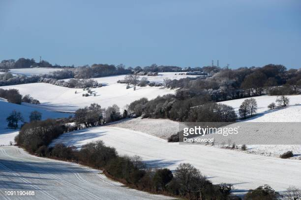 Light dusting of snow covers hillsides near Biggin Hill Airport on January 30, 2019 near Biggin Hill, United Kingdom. Some travelers have faced...