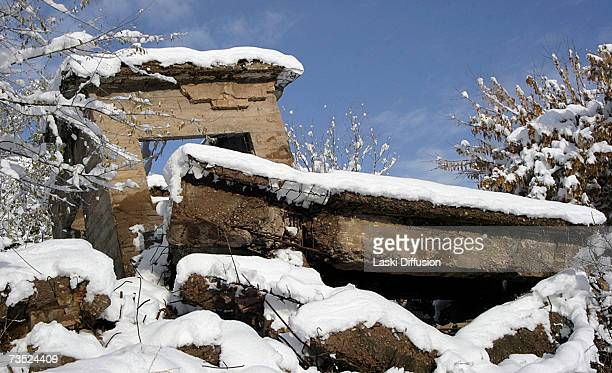 A light dusting of snow sits on the ruins of an old Soviet uranium plant in this photo taken in January 2007 in the town of MailuuSuu in Kyrgystan...