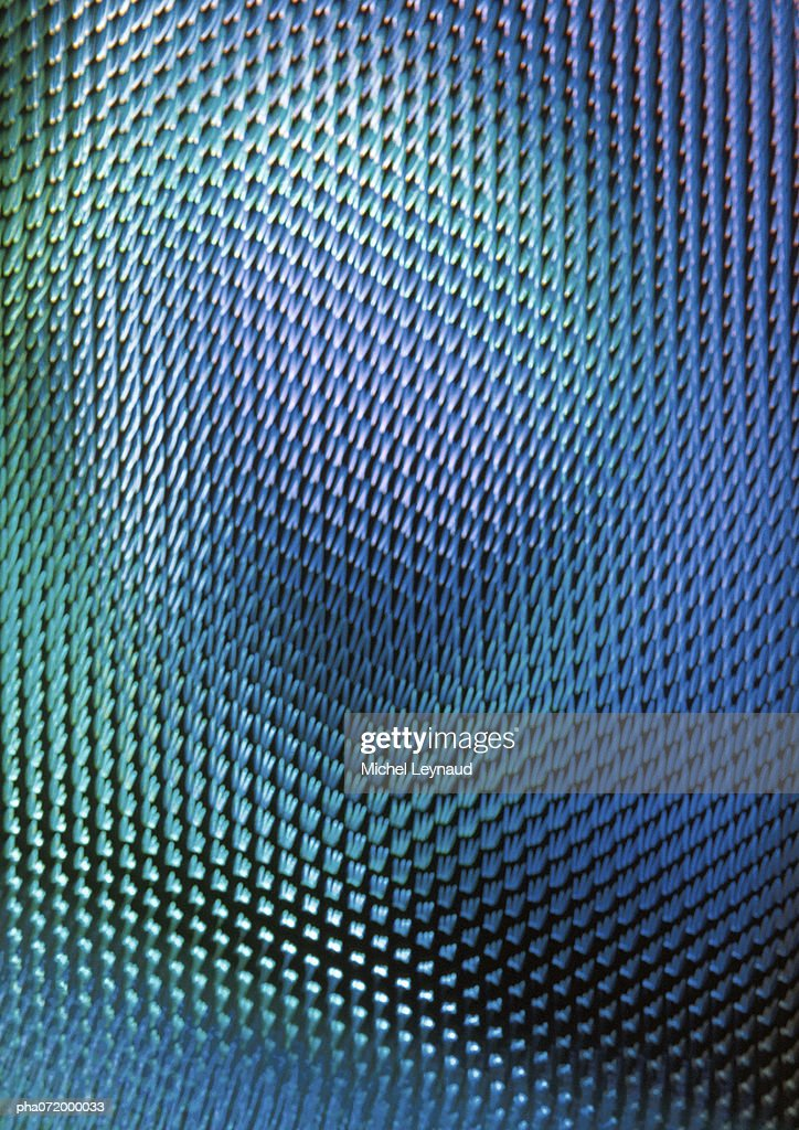 Light effect on textured surface, blues and greens, full frame : Stockfoto
