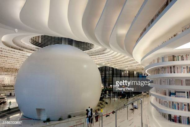 Light effects of Tianjin Binhai Cultural center Library at night. With a huge spherical multi-function hall and circle steps to the ceiling, Tianjin...