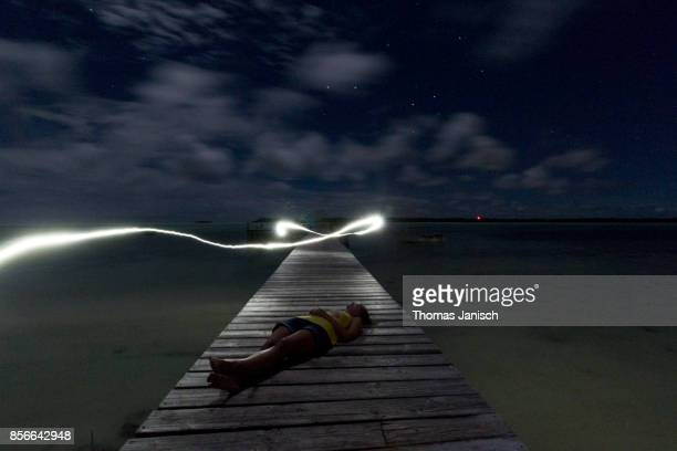 Light effects on a wooden jetty