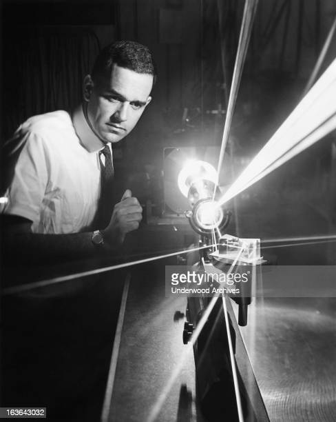 Light emitting from a high power continuouswave argon ion laser at the Hughes Aircraft research laboratories Malibu California 1964 It is an eight...