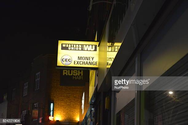 Light emitting from the sign of Western Union in London on Friday 27th March 2015 Western Union based in the United States is a multinational...