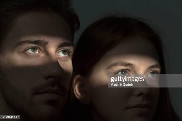 Light falling on couples eyes in dark