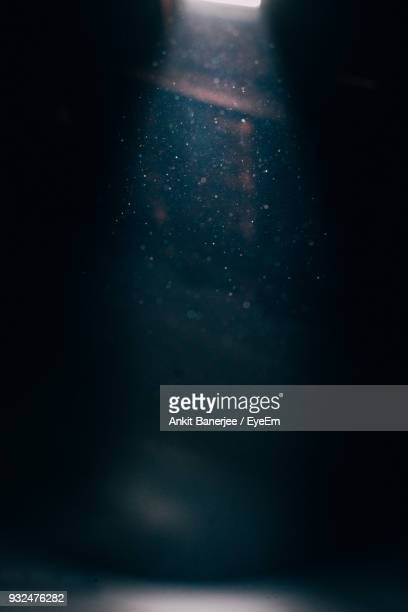 light falling on dust at night - dust stock pictures, royalty-free photos & images