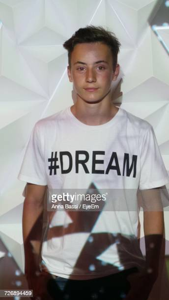 Light Falling On Teenage Boy Wearing T-Shirt With Dream Text