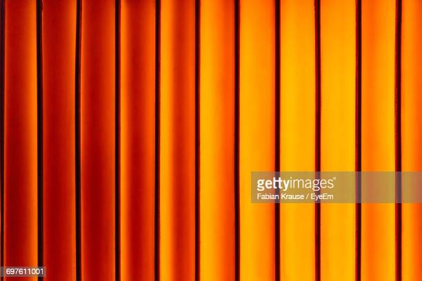 light falling on wall - orange farbe stock-fotos und bilder