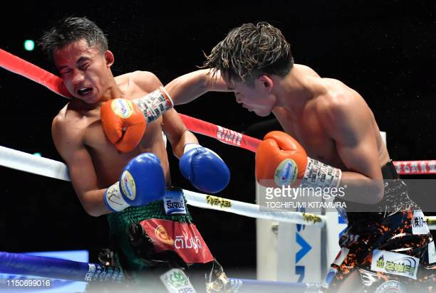 WBA light flyweight boxing champion Hiroto Kyoguchi of Japan punches challenger Tanawat Nakoon of Thailand during their title bout at the Makuhari...