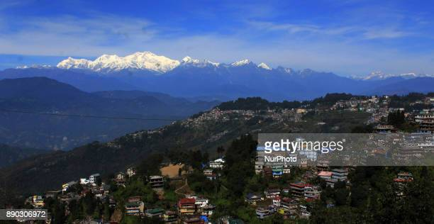 Light from a sunrise is cast on mountain Kangchenjunga near Darjeeling on December 11 2017 Kangchenjunga is the third highest mountain in the world...