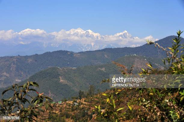 Light from a sunrise is cast on the Indian Kangchenjunga mountain at Ravangla village in South Sikkim on February 25 2013 Kangchenjunga is the third...