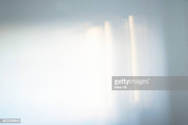 Light from a window reflected on a wall