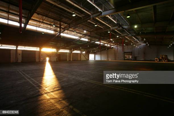 Light from doorway in vacant warehouse