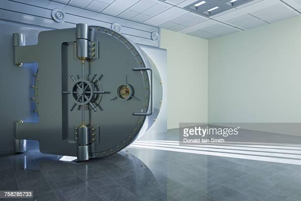 light from open vault door - bankieren stockfoto's en -beelden