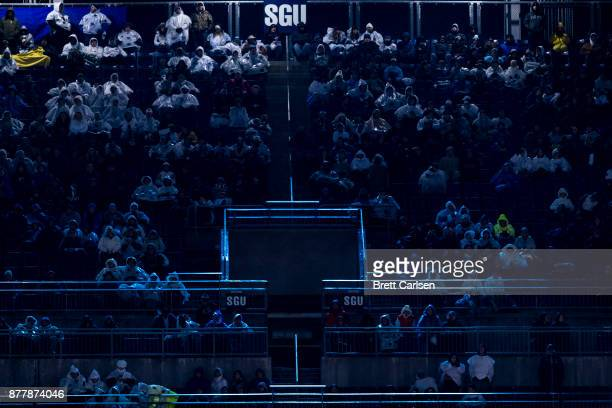 light from the stadium scoreboard illuminates fans during the second half between the Penn State Nittany Lions and the Nebraska Cornhuskers on...