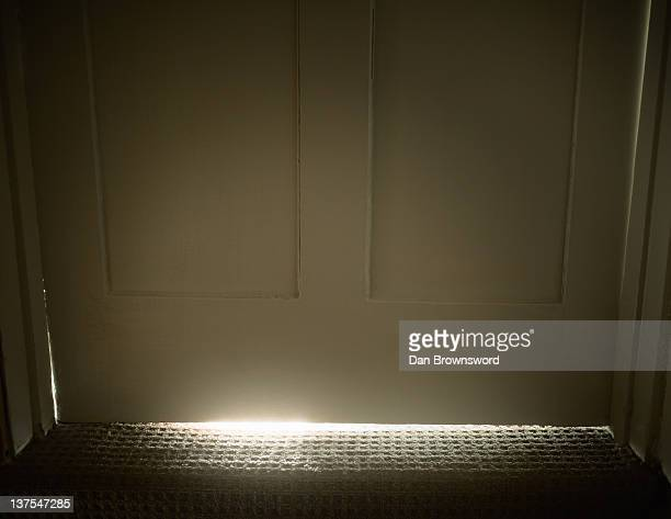 Light glowing from under door