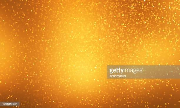 Light gold sparkles on a darker and light gold background