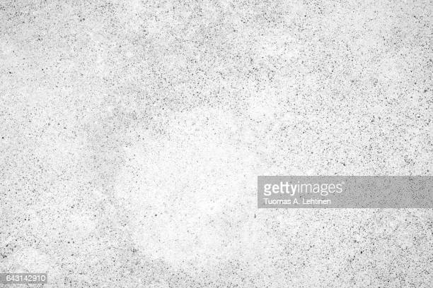 Light gray concrete wall texture background, paint partly faded, in black&white.