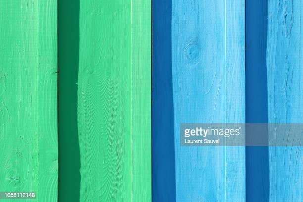light green and light blue painted wood background - laurent sauvel photos et images de collection