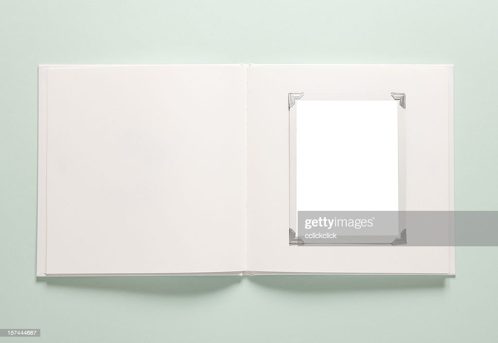 Light green background with a white empty photo album : Stock Photo