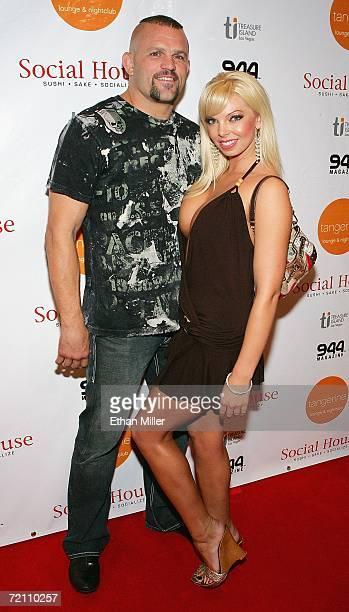 UFC light heavyweight champion Chuck Liddell and model Jasmine Fiore arrive at the Tangerine Lounge Nightclub at the Treasure Island Hotel Casino...