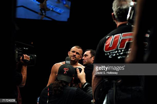 """Light Heavyweight Champion Chuck """"The Iceman"""" Liddell speaks with UFC host Joe Rogan after successfully defending his title against Renato """"Babalu""""..."""
