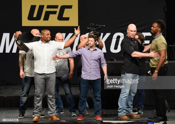 UFC light heavyweight champion Daniel Cormier and Jon Jones face off during the UFC Summer Kickoff Press Conference at the American Airlines Center...