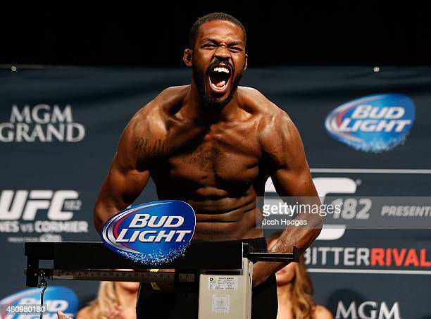 UFC light heavyweight champion Jon 'Bones' Jones poses on the scale after weighing in during the UFC 182 weighin event at the MGM Grand Conference...