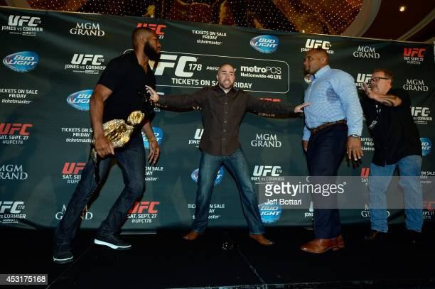 UFC light heavyweight champion Jon Jones and challenger Daniel Cormier are separated after facing off during the UFC 178 Ultimate Media Day at the...