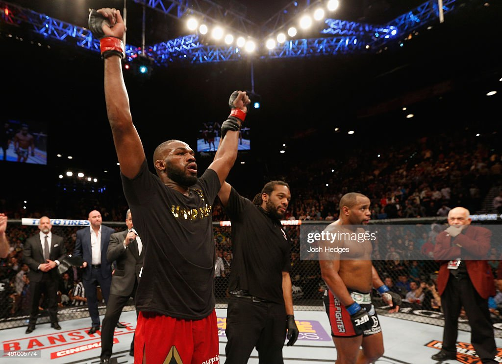UFC light heavyweight champion Jon Jones (L) celebrates his win over Daniel Cormier (R) in their UFC light heavyweight championship bout during the UFC 182 event at the MGM Grand Garden Arena on January 3, 2015 in Las Vegas, Nevada.