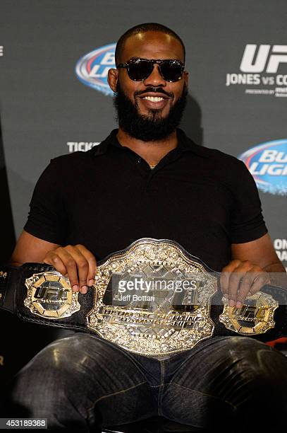 Light heavyweight champion Jon Jones holds his championship belt for the fans during the UFC 178 Ultimate Media Day at the MGM Grand Hotel/Casino on...