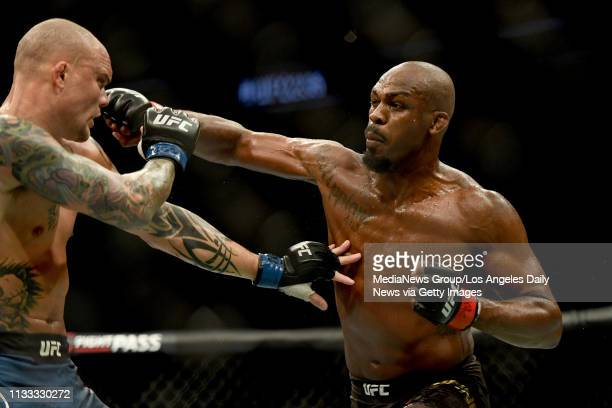 UFC light heavyweight champion Jon Jones lands a punch to the head of challenger Anthony Smith Jones defeated Smith via unanimous judges decision...